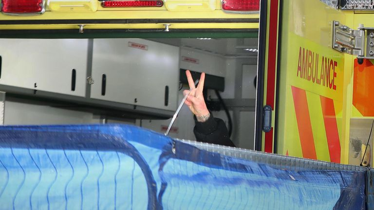 The final anti-HS2 protester flashes a V-sign from the back of an ambulance