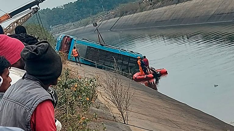 An official said the overcrowded bus drove off a bridge and into a canal