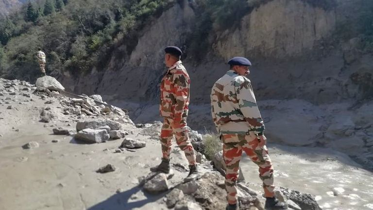 This photograph provided by Indo Tibetan Border Police (ITBP) shows ITBP personnel arriving for rescue work after a portion of Nanda Devi glacier broke off in Tapovan area of the northern state of Uttarakhand sending a massive flood of water, mud and debris into areas below, India, Sunday, Feb.7, 2021. (Indo Tibetan Border Police via AP)