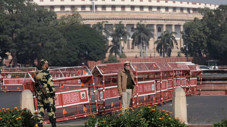 Security personnel stand guard next to barricades outside the Parliament where annual budget is being presented in New Delhi
