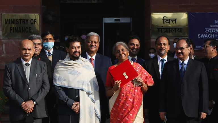 Finance Minister Nirmala Sitharaman holds up a folder ahead of her presentation of the federal budget