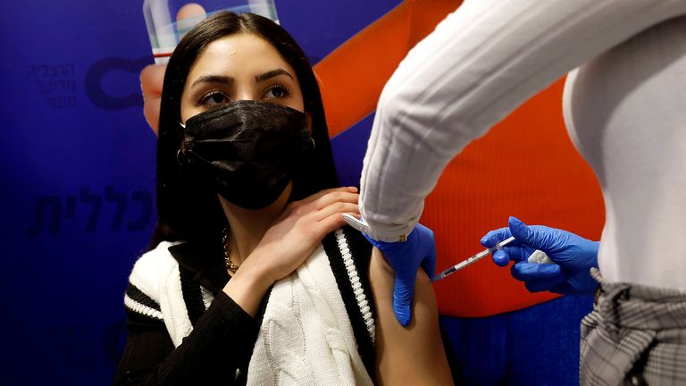 FILE PHOTO: A woman receives a vaccination against the coronavirus disease (COVID-19) at a temporary Clalit Healthcare Maintenance Organization (HMO) centre, in Herzliya, Israel February 3, 2021. REUTERS/Amir Cohen/File Photo