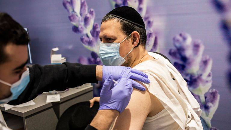 A man receives a dose of the Pfizer/BioNTech vaccine in Israel. Pic: AP