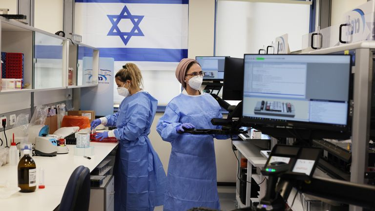 Technicians work at Healthcare Maintenance Organisation (HMO) Maccabi's coronavirus disease (COVID-19) public laboratory, performing diverse and numerous tests, in Rehovot, Israel February 9, 2021. Picture taken February 9, 2021. REUTERS/Ammar Awad