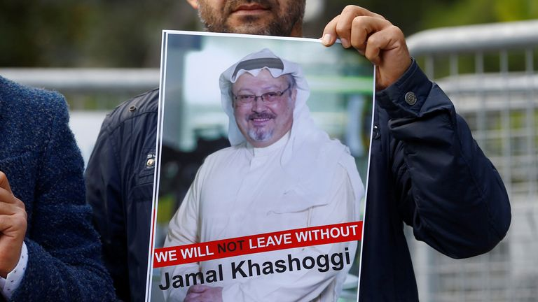 A demonstrator holds picture of Saudi journalist Jamal Khashoggi during a protest in front of Saudi Arabia's consulate in Istanbul in 2018