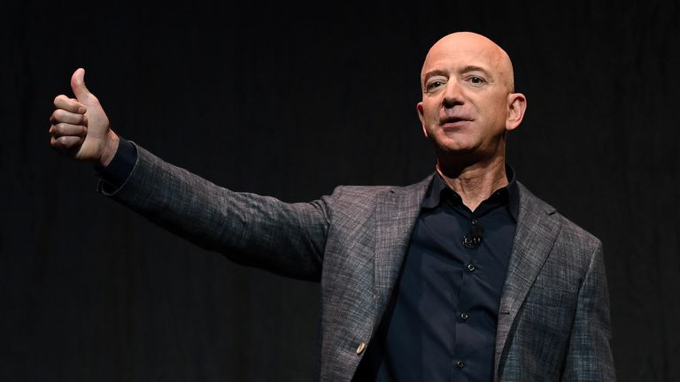Founder, Chairman, CEO and President of Amazon Jeff Bezos gives a thumbs up as he speaks during an event about Blue Origin's space exploration plans in Washington, U.S., May 9, 2019