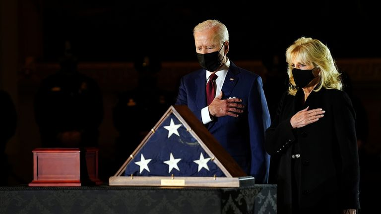 U.S. President Joe Biden and first lady Jill Biden pay their respects to late Capitol Police officer Brian Sicknick, who died on Jan. 7 from injuries he sustained while protecting the U.S. Capitol during the Jan. 6 attack on the building, who lies in honor in the Rotunda of the U.S Capitol, in Washington, U.S. February 2, 2021. Erin Schaff/Pool via REUTERS