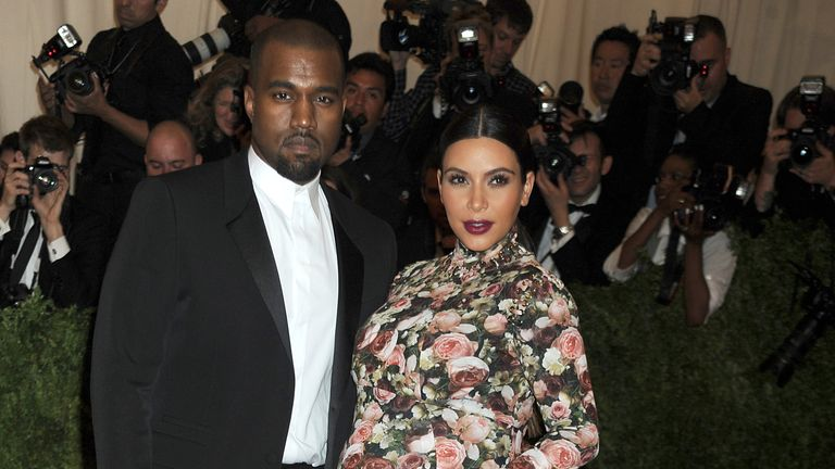 Kim Kardashian West and Kanye West Welcome Baby Boy Via Surrogate. NEW YORK, NY - MAY 06: Kanye West and Kim Kardashian at the 'PUNK: Chaos to Couture' Costume Institute Benefit Gala at the Metropolitan Museum of Art on May 6, 2013 in New York City. Pic: mpi01/MediaPunch /IPX