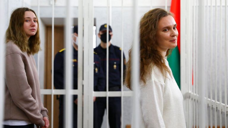 Katsiaryna Andreyeva (right) and Daria Chultsova were held inside a cage in a Minsk courtroom. Pic: AP