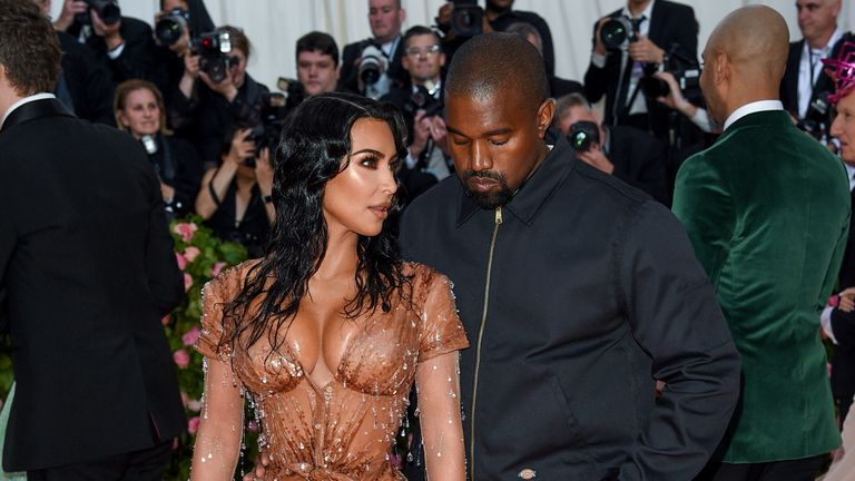"Kim Kardashian West, left, and Kanye West attend The Metropolitan Museum of Art's Costume Institute benefit gala celebrating the opening of the ""Camp: Notes on Fashion"" exhibition on Monday, May 6, 2019, in New York. (Photo by Evan Agostini/Invision/AP)"