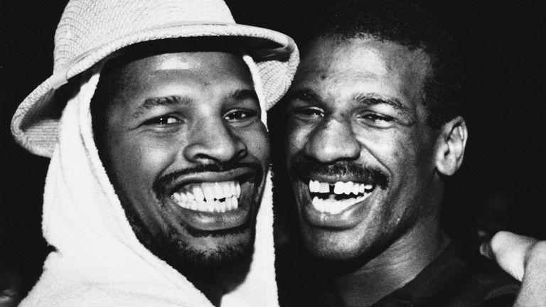 Leon Spinks, left, hugs his brother Michael after he defeated Larry Holmes in 1985. Pic: Associated Press