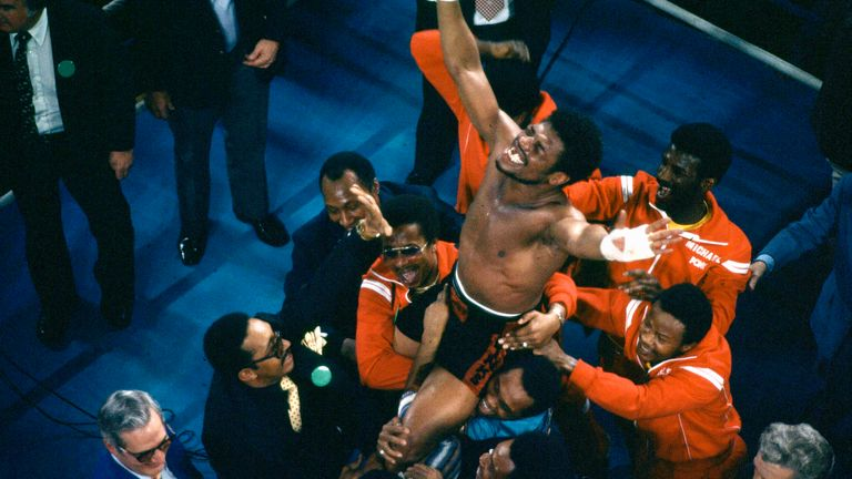 Leon Spinks' entourage holds him aloft as he celebrates his victory over Ali. Pic: AP