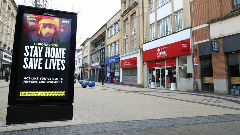 A 'Stay Home Save Lives' sign on Broadmead in Bristol during England's third national lockdown to curb the spread of coronavirus. (Andrew Matthews/PA)