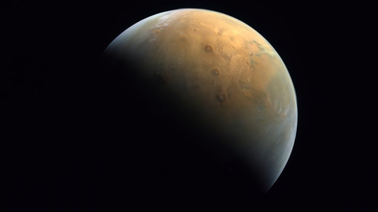"This Feb. 10, 2021 image taken by the United Arab Emirates' ""Amal,"" or ""Hope,"" probe was released Sunday, Feb. 14, 2021, shows Mars"