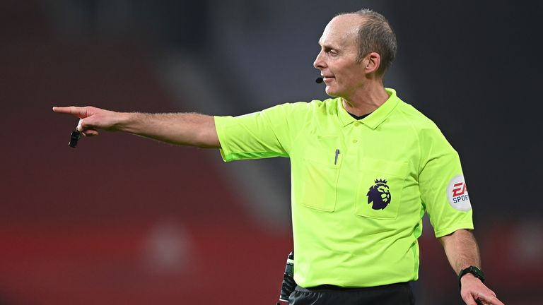 Referee Mike Dean has reported the messages to police. Pic: Laurence Griffiths/Pool via AP
