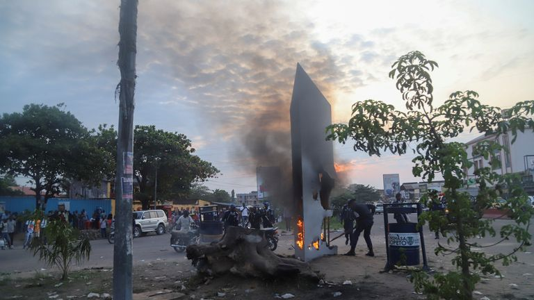 Residents set fire to mysterious monolith that appeared in Kinshasa, Democratic Republic of Congo February 17, 2021. REUTERS/Kenny Katombe