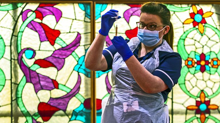 A nurse at Bradford Central Mosque,, which has become a community COVID-19 vaccination centre