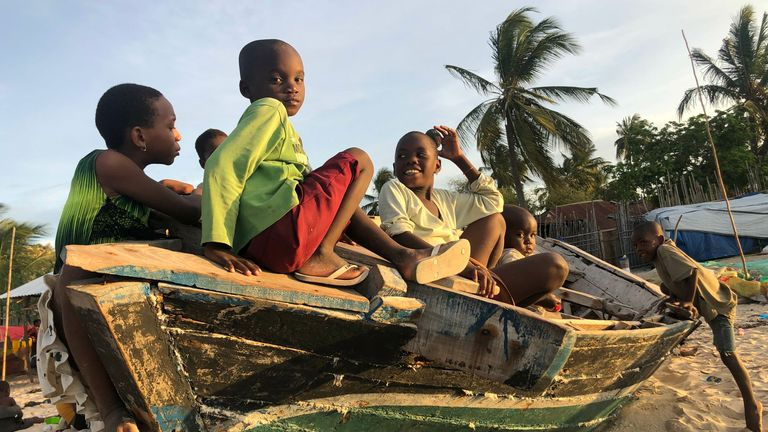 Families are sleeping on the beach in Pemba after being ousted from their homes by militants