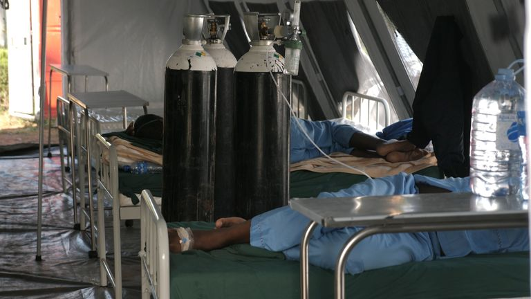Patients lie in the temporary COVID tents set up in Maputo, Mozambique