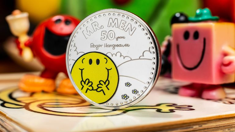 The Royal Mint unveils a new £5 Mr Happy coin, which launches today to celebrate 50 years of the Mr Men and Little Miss characters