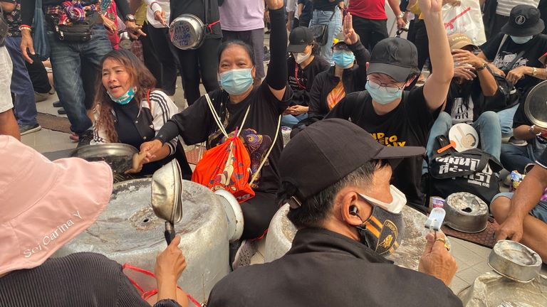 A makeshift orchestra was created from upturned cook wear and people were enthusiastically beating it as speakers shouted pro-democracy messages
