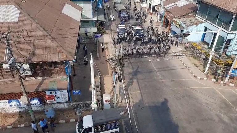 Police form up at a junction in Dawei