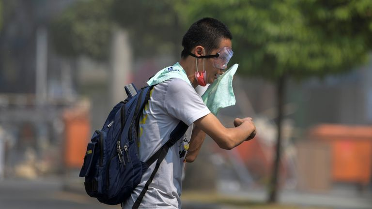 A protester flees from teargas during a rally