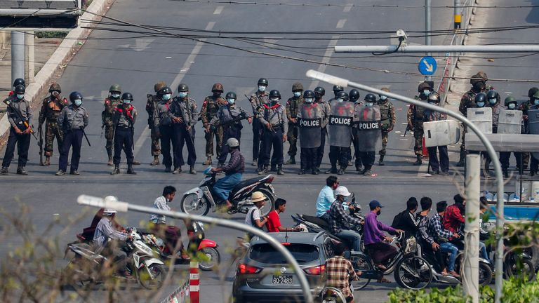 Police blocked a road in Mandalay on Saturday