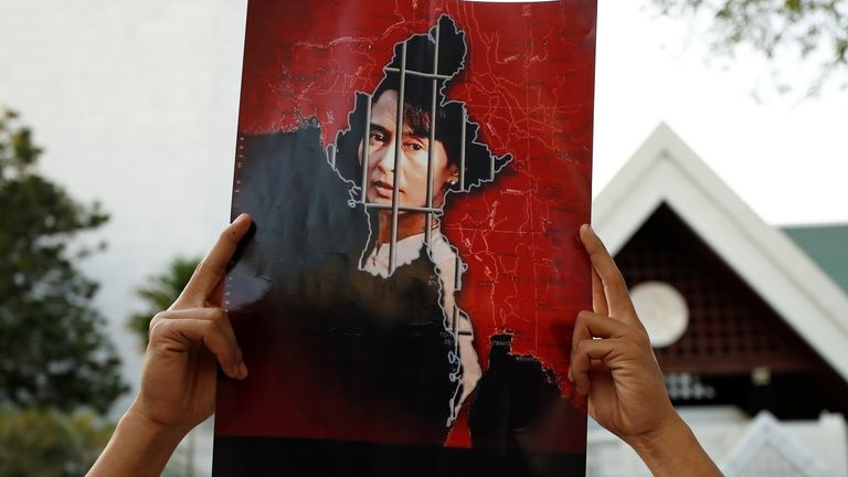 A Myanmar citizen holds up a picture of leader Aung San Suu Kyi after the military seized power in a coup in Myanmar, outside United Nations venue in Bangkok, Thailand February 2, 2021. REUTERS/Jorge Silva