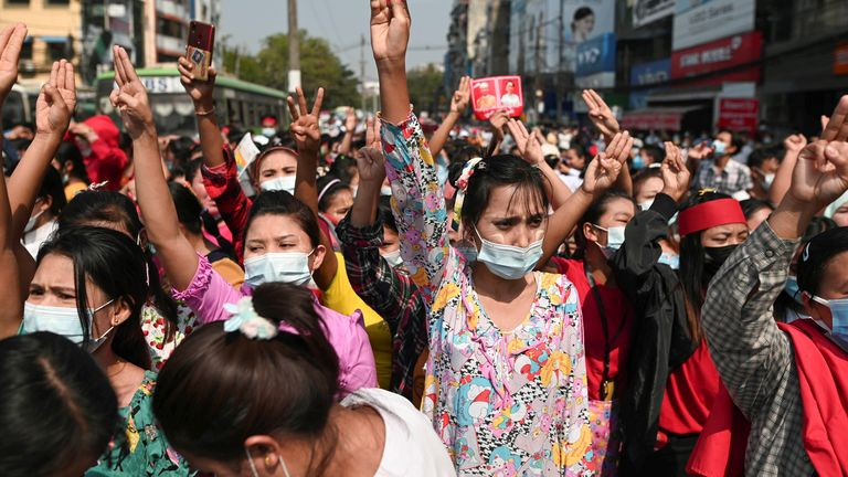 Demonstrators in Yangon show the three-finger salute to protest against the military coup and demand Aung San Suu Kyi be released