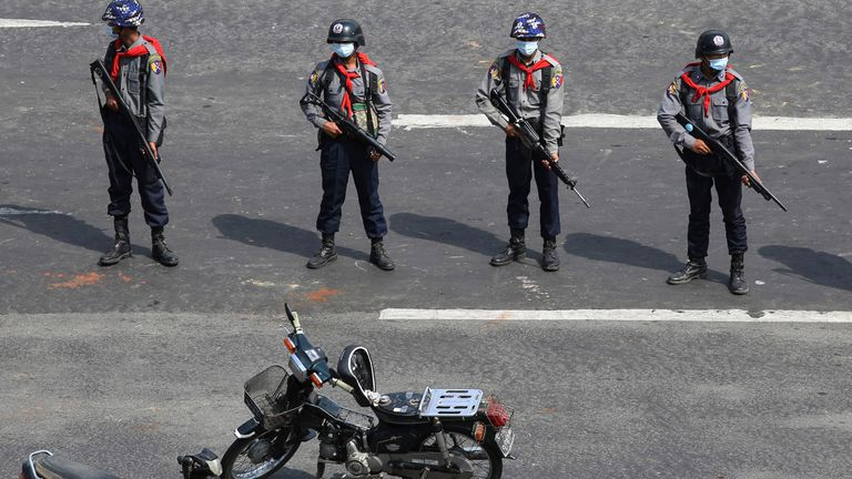Police stand guard in Naypyitaw - there are fears deadly force could end up being used