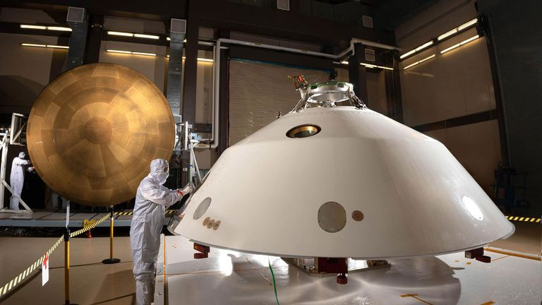 The Mars 2020 spacecraft's backshell (foreground) and heat shield (background) were fitted with MEDLI2, a suite of sensors to measure the vehicle's environment and performance during its turbulent descent to Mars. Credit: NASA/JPL-Caltech