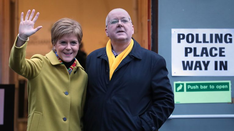 SNP leader Nicola Sturgeon with husband Peter Murrell as they cast their votes in the 2019 General Election