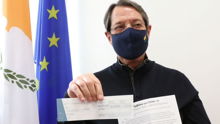 Cypriot President Nicos Anastasiades shows his COVID vaccination certificate