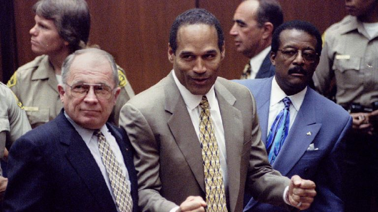 OJ Simpson (centre) reacts after the court clerk announces he has been found not guilty of the murders of Nicole Simpson and Ronald Goldman
