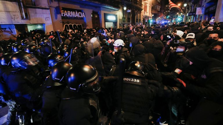 Demonstrators clash with police as supporters of arrested Catalan rapper Pablo Hasel protest in Barcelona, Spain, February 20, 2021. REUTERS/Albert Gea