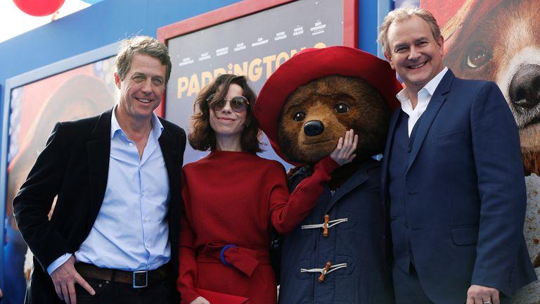 Hugh Grant (L), Sally Hawkins and Hugh Bonneville at the LA premiere of Paddington 2 in 2018