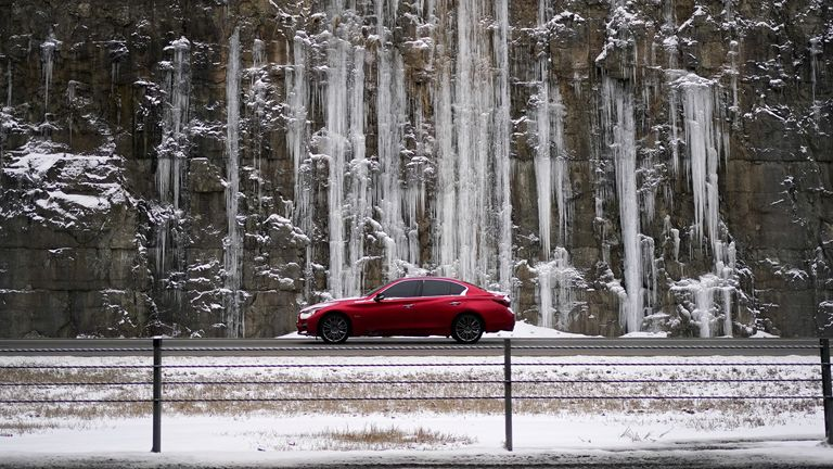 A car drives past rock covered in ice in Louisville, Kentucky