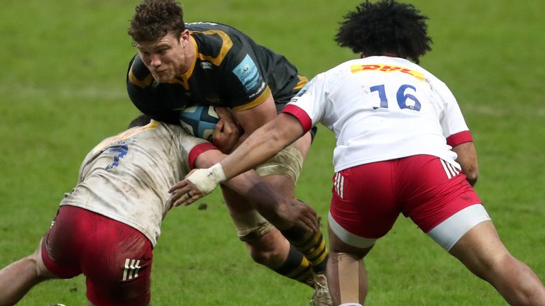 Wasps' Will Rowlands (centre) is tackled by Harlequins' William Evans (left) and Elia Elia (right) during the Gallagher Premiership match at the Ricoh Arena, Coventry. Picture date: Sunday January 31, 2021.