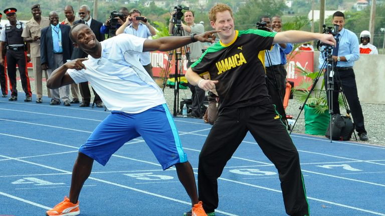 Britain's Prince Harry, right, and Olympic sprint champion Usain Bolt pose for photographers doing Bolt's landmark gesture after a mock race in Kingston, Jamaica, Tuesday March 6, 2012. The Prince is in Jamaica as part of the Diamond Jubilee tour in honor of Queen Elizabeth II who celebrates 60 years on the throne. His visit comes as the new prime minister, Portia Simpson Miller, has called anew for the severing of ties with the British monarchy. (AP Photo/Collin Reid)