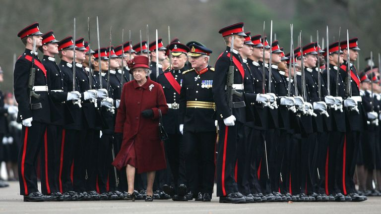 Queen Elizabeth ll inspects the graduates at the Sovereign's Parade at the Royal Military Academy Sandhurst on December 15, 2006...Pool/Anwar Hussein Collection