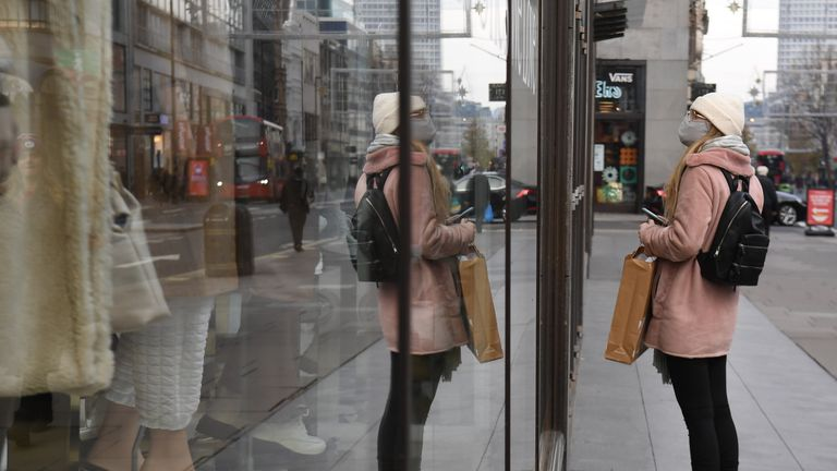 """A woman stops to window shop at a Topshop store on Oxford Street, London, part of the Arcadia Group. Sir Philip Green's Arcadia retail empire has said it is working on """"contingency options to secure the future of the group's brands"""" after reports it will collapse into administration within days, with 15,000 jobs at risk. Read less"""