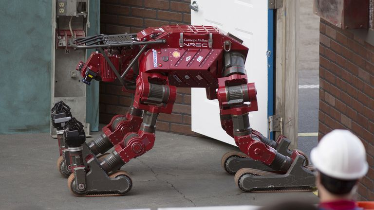 The Tartan Rescue team CHIMP (CMU Highly Intelligent Mobile Platform) robot gets up after falling on a simulated disaster-response course on day one of the DARPA (Defense Advanced Research Projects Agency) Robotics Challenge finals in Pomona, California, June 5, 2015. The DARPA-sponsored event drew robotic teams from around the world to compete in a series of eight challenges throughout the course. REUTERS/David McNew