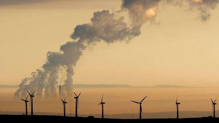 Steam rises from a power station behind the Royd Moor Wind Farm in Penistone near Sheffield, northern England, in this October 19, 2007 (file pic)