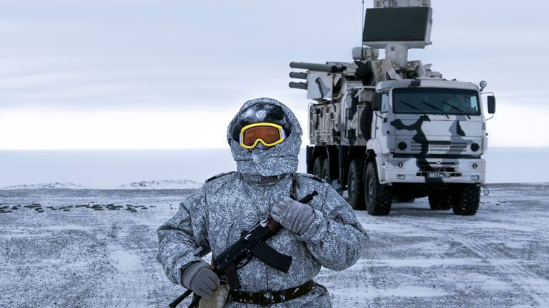 In this photo taken on Wednesday, April 3, 2019, a Russian solder stands guard as Pansyr-S1 air defense system on the Kotelny Island, part of the New Siberian Islands archipelago located between the Laptev Sea and the East Siberian Sea, Russia. Russia has made reaffirming its military presence in the Arctic the top priority amid an intensifying international rivalry over the region that is believed to hold up to one-quarter of the planet's undiscovered oil and gas (AP Photo/Vladimir Isachenkov)