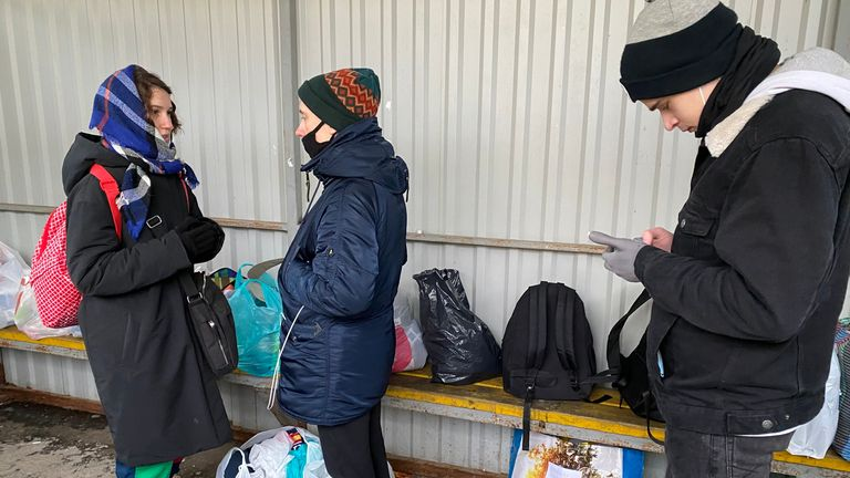 At a detention centre at Sakharova, people queue to deliver food and supplies to friends and relatives inside