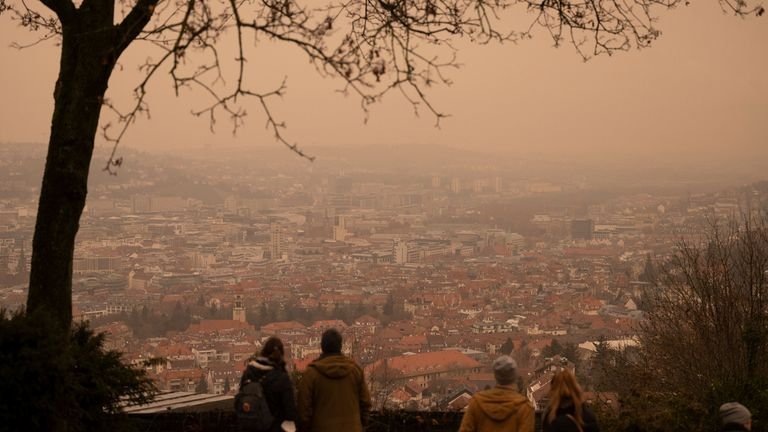 06 February 2021, Baden-Wuerttemberg, Stuttgart: Yellow-reddish skies appear over downtown from a vantage point because there is supposed to be Sahara dust in the air. Photo by: Marijan Murat/picture-alliance/dpa/AP Images