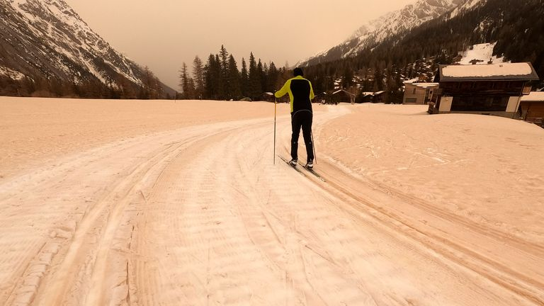 View of the cross-country ski track covered with sand, on Saturday, 6 February 2021, at La Fouly in the Val Ferret, Switzerland. The sand of the Sahara has visibly darkened the sky in some places in Switzerland today. After an already increased concentration of dust from the African desert on Friday, even more sand was streaming into Switzerland on Saturday, Meteosuisse reported. (Salvatore Di Nolfi/Keystone via AP)