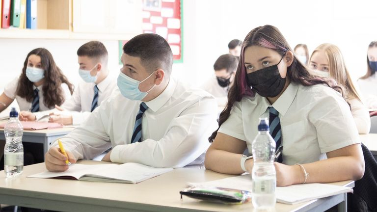 S5 and S6 pupils at St Columba's High School in Gourock, Inverclyde, wear protective face masks during their history lesson