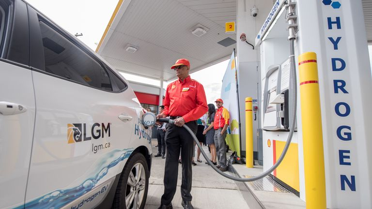 A Shell worker refuels a vehicle at the first retail hydrogen fuelling station in Vancouver, Canada in this undated handout image. Photographic Services, Shell International Limited/Handout via REUTERS